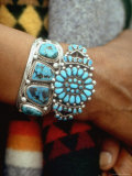Close Up of Wrist Modeling Turquoise Bracelets Made by Native Americans Photographic Print by Michael Mauney