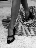 Artful Shot of Model Showing Off a Pair of High Heel Shoes Premium Photographic Print by Nina Leen