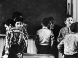 Young Boys Horsing Around in a New York City Grade School Classroom Premium Photographic Print by Howard Sochurek