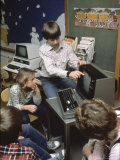 Kids Getting a Computer Lesson Premium Photographic Print by Charles Bonanno