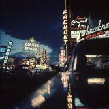 Fremont Street at Night Lit Up by Gambling Casino Neon Signs Reproduction photographique par Nat Farbman
