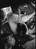 Senator Robert Kennedy Driving Car with Pet Springer Spaniel over His Lap and Son Max Beside Him Photographie par Bill Eppridge
