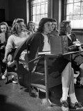 High School Student Passing Note to Classmate Sitting Behind Her Lámina fotográfica de primera calidad por Nina Leen