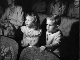 Children Watching Cartoons in a Movie Theater Photographic Print by Charles E. Steinheimer