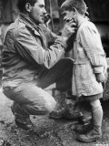 American Soldier Walton Trohon Cleaning the Face of a Young French Orphan During WWII Photographic Print