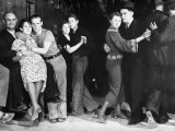 Construction Workers and Taxi Dancers Enjoying a Night Out in Barroom in Frontier Town Fotografie-Druck von Margaret Bourke-White