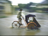 Man Driving Rickshaw During Monsoon Season Premium Photographic Print by John Dominis