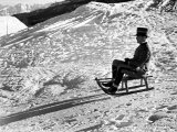 Italian Officer Enjoying a Sled Ride in the Italian Alps Reproduction photographique par Alfred Eisenstaedt