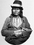 Asa-to-Yet, Native American Comanche Chief, Sitting with Arms Crossed and Gun in Hand Premium Photographic Print by Will Soule