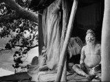 Hindu Holy Man Sitting in His Home Premium Photographic Print by James Burke