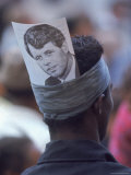 Admirer of Presidential Contender Bobby Kennedy Wearing a Photograph of Him Tucked Into Headband Premium Photographic Print by Bill Eppridge