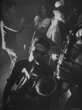 Jitterbugging at La Rose Rouge, with Saxophones Being Played in Foreground Premium Photographic Print by Gjon Mili