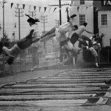 People Jumping in a Roadside Trampoline Park in LA called Jess Robinson's Trampoline Club Photographic Print by Ralph Crane