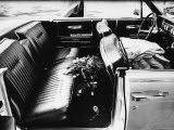 Flowers on the Backseat of Vice President Lyndon Johnson's Lincoln Convertible at Parkland Hospital Premium Photographic Print by Art Rickerby