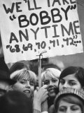 Girls Holding Up Sign For Robert F. Kennedy During Campaign Premium Photographic Print by Bill Eppridge