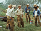 Cowboys on the King Ranch Stand Around During a Break from Rounding Up Cattle Premium Photographic Print by Ralph Crane