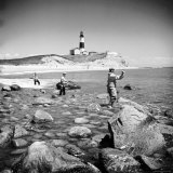 Surf Casting Fishermen Working the Shore Near the Historic Montauk Point Lighthouse Photographic Print by Alfred Eisenstaedt
