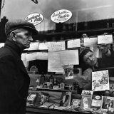 Shopkeeper Posts Handwritten Advertisements in His Window Following World War II, c.1946 Photographic Print by George Rodger