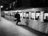 Commuter on the New York New Haven Line Running to Catch Train Pulling Out of Grand Central Station Fotoprint van Alfred Eisenstaedt