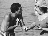 Italian Man Talking to a Woman While Enjoying a Day at the Beach Premium Photographic Print by Paul Schutzer