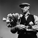 Tulip Farmer with an Armful of Flowers in the Netherlands, c.1946 Photographic Print by George Rodger