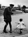 Canadian Mountie is Taken Off Guard by Little Girl Rushing to See Visiting Queen Elizabeth Photographic Print by Alfred Eisenstaedt