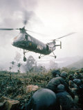 American Helicopter H-21 Hovering Above Soldiers in Combat Zone During Vietnam War Premium Photographic Print by Larry Burrows