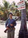 Guard on Duty Beneath a No Smoking Sign on Tarawa During WWII Premium Photographic Print by J. R. Eyerman