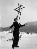 Head Waiter Rene Breguet Balancing Chair on Chin at Ice Rink of Grand Hotel Premium Photographic Print by Alfred Eisenstaedt