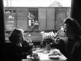 "Wife and Daughter of US Soldier in First Class Dining Car Looking at German ""Expelles"" in Boxcars Photographic Print by Walter Sanders"