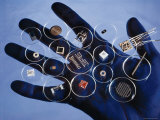 Handful of Microelectronic Parts Photographic Print by Fritz Goro
