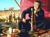 Arab Shepherd Smoking His Hookah as He Relaxes in a Roadside Tea Tent Premium Photographic Print by Carlo Bavagnoli