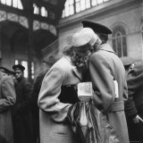 Couple in Penn Station Sharing Farewell Embrace Before He Ships Off to War During WWII Photographic Print by Alfred Eisenstaedt