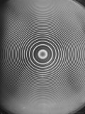 Lamp Throwing Light Patterns of Rings Onto a Blank Surface Premium Photographic Print by Andreas Feininger
