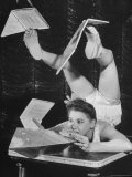 Contortionist Assembling a Dymaxion Map Premium Photographic Print by Wallace Kirkland