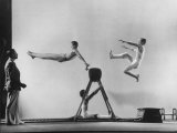 Erik Flensted Jensen, Coach of Danish Gymnastic Team, Watching as Three Men Perform Premium Photographic Print by Gjon Mili