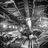 "American ""Flying Nurse"", Julia Corinne Riley, Checks on Patients Aboard C-47 Transport Plane Photographic Print by Eliot Elisofon"