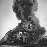 Engine Spewing Smoke as Train Proceeds En Route Photographic Print by John Phillips
