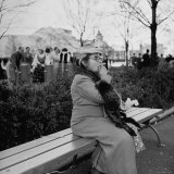 Woman Sitting on a Park Bench While Eating Her Lunch at the New York World's Fair Photographic Print by David Scherman
