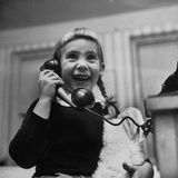 Young Girl Talking to Santa Claus on the Telephone Photographic Print by Martha Holmes