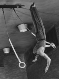 Intercollegiate Champion Gymnast Newt Loken on Flying Rings Doing Reverse Flyaway with Half Twist Photographic Print by Gjon Mili