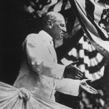 Woodrow Wilson, 28th President of the U.S, Speaking from Podium under Flag Bunting Photographic Print