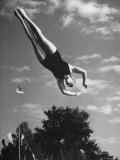 Diver Barbara Ramser Performing Dive Premium Photographic Print by Gordon Coster