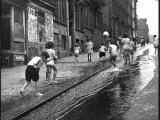 Children Playing on 103rd Street in Puerto Rican Community in Harlem Photographie par Ralph Morse