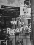 Franklin D. Roosevelt Poster Hanging in a Repair Store Window on Madison Avenue Photographic Print by John Phillips