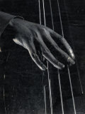 Hand of Bass Player on the Strings During Jam Session at Photographer Gjon Mili's Studio Premium-Fotodruck von Gjon Mili