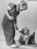 Little Girl Playing with Dog Photographic Print by Gjon Mili