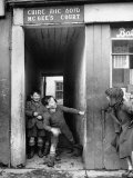 Children Playing at the Entrance to McGee's Court Slum on Camden Street Photographic Print by Tony Linck