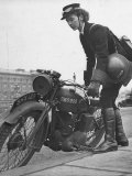 Woman Dispatch Rider Standing Beside Her Motorcycle Premium Photographic Print by Hans Wild