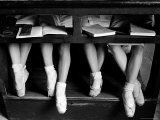 Close Up of Legs of Young Ballerinas in Toe Shoes under Desk at La Scala Ballet School Premium Photographic Print by Alfred Eisenstaedt